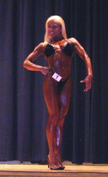 My last competiion. 3 1st place trophies, the overall, and my wins gave my gym the best in show award.